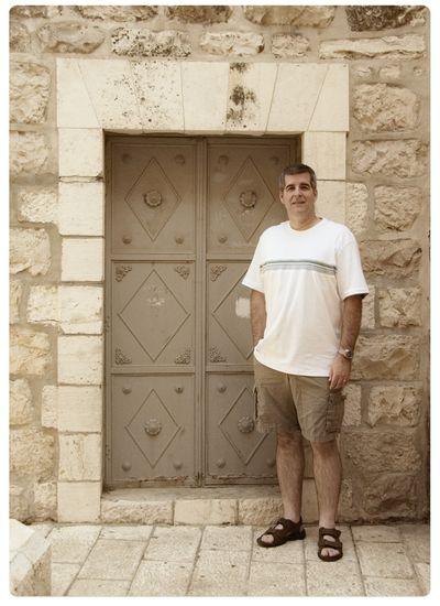 Rick in front of a door